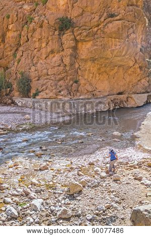Young tourist in Todgha Gorge, Morocco