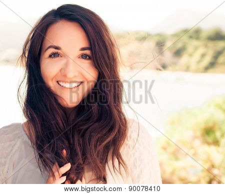 Young brunette woman in white dress. Happy summer time.
