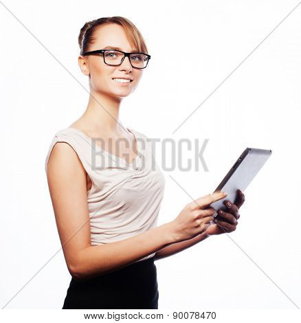 Business, finance and people concept: young business woman wearing glasses  working on tablet