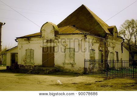 Facade brick destroyed building shop in the Russian province