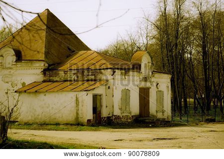 Small ruined brick shop in the Russian province