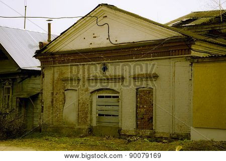 Facade of the destroyed building with boarded up windows a bakery