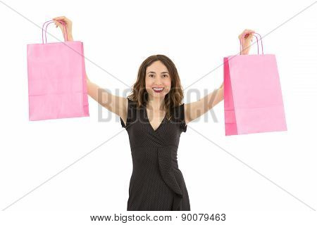 Woman Lifting The Pink Shopping Bags Up