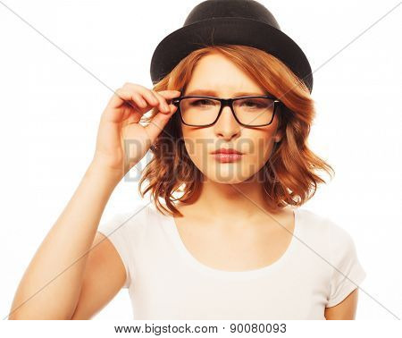 life style, happiness, emotional  and people concept: Beautiful young  woman wearing black hat and eyeglasses looking at camera and make different emotions while standing against white background