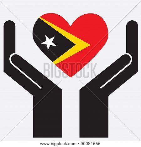 Hand showing East Timor flag in a heart shape.