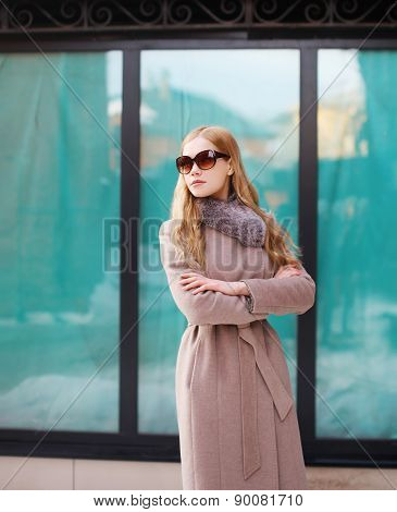 Beautiful Elegant Woman Dressed A Coat And Sunglasses In The City