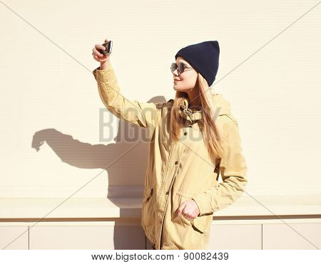 Fashion Pretty Blonde Makes Selfie-portrait On The Smartphone, Carefree Hipster Girl Wearing A Black