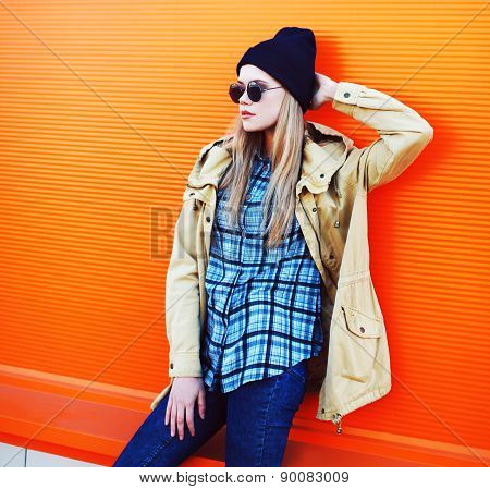 Outdoor Fashion Portrait Of Stylish Hipster Girl Posing In The City Against A Colorful Wall
