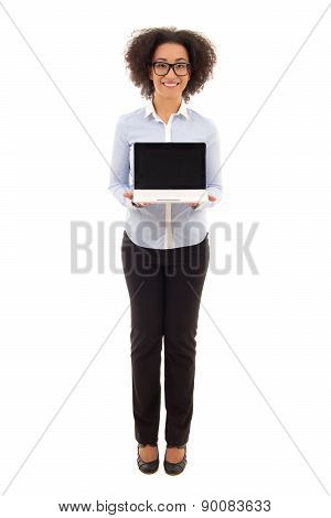 Young Beautiful African American Business Woman Holding Laptop With Blank Screen Isolated On White