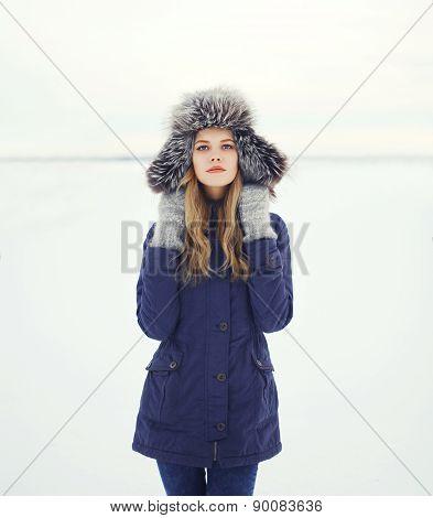 Portrait Of A Beautiful Woman In A Fur Hat, Winter Field