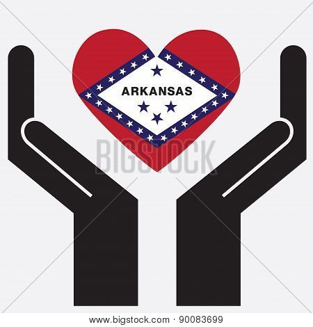 Hand showing Arkansas flag in a heart shape.