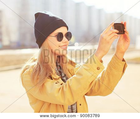 Portrait Pretty Blonde Makes Selfie-portrait On The Smartphone, Carefree Hipster Girl Wearing A Blac