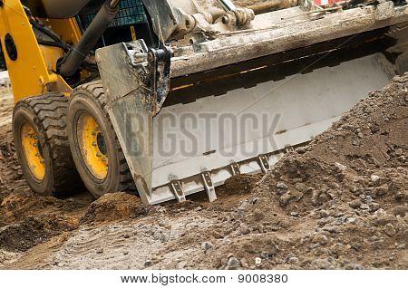 Closeup skid steer loader excavator at road construction work poster