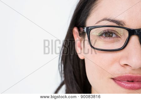 Pretty brunette wearing eye glasses on white background