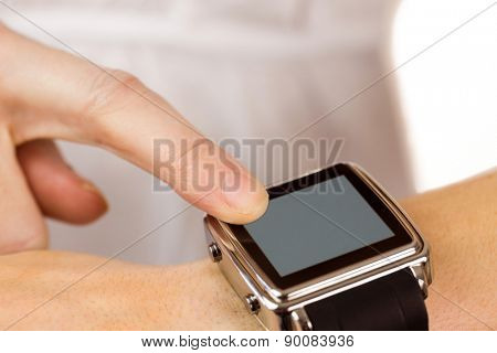 Woman using her smart watch on white background