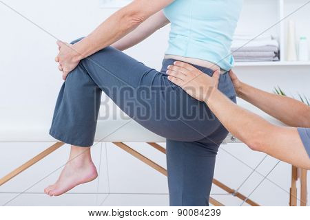 Physiotherapist examining his patient back in medical office