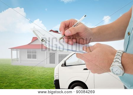 Delivery man writing on clipboard against blue sky