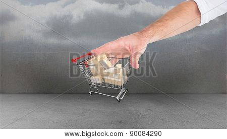 Hand showing against clouds in a room