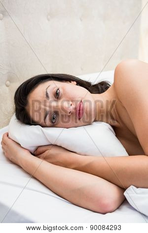 Pretty brunette trying to sleep on bed at home
