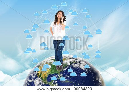Attractive casual brunette having phone call against cloud computing graphic with connecting lines