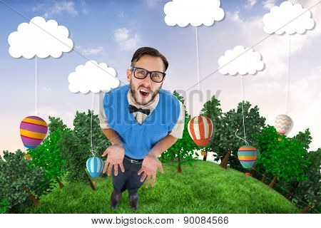Geeky hipster looking confused at camera against hot air balloons hanging from clouds