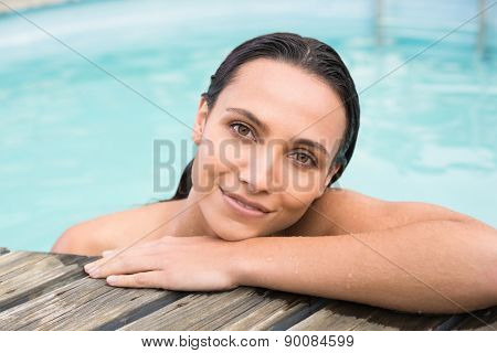 Beautiful woman in bikini relaxing in swimming pool
