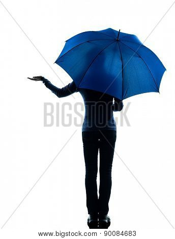 one  woman rear view holding umbrella umbrella palm gesture in silhouette studio isolated on white background