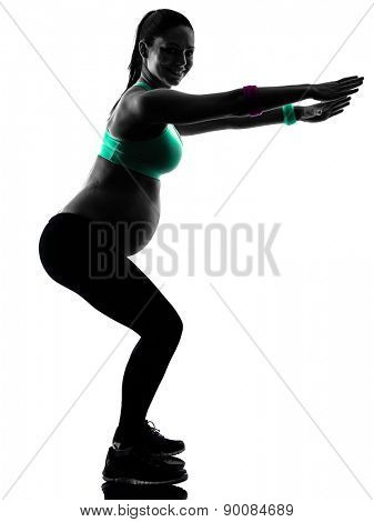 one caucasian pregnant woman exercising fitness exercises  in silhouette studio isolated on white background
