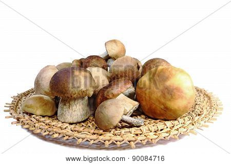 Mushrooms In A Wicker Dish On A White Background.