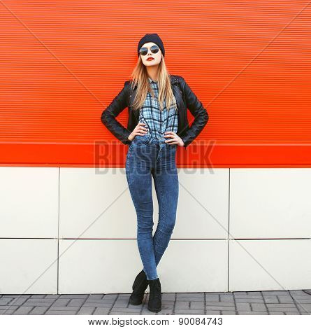 Street Fashion Concept - Stylish Hipster Woman In Rock Black Style Posing Against A Colorful Urban W