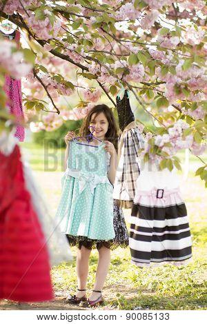 Little Girl Tries On Dresses