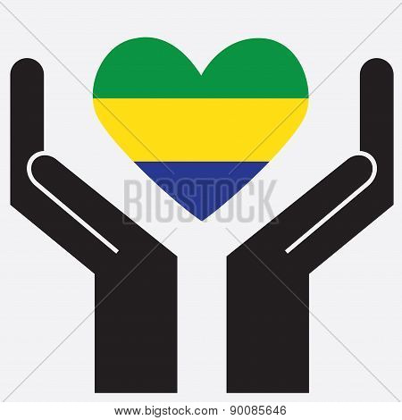 Hand showing Gabon flag in a heart shape.
