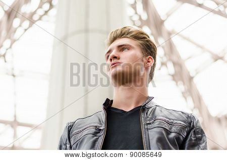 Attractive blond young man in city environment