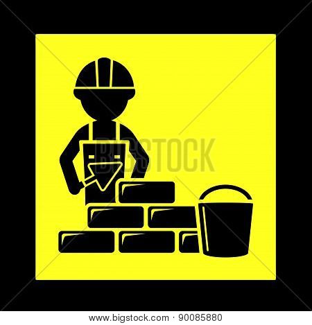 builder with brick wall icon