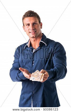 Young man with euro bills or banknotes in his hands