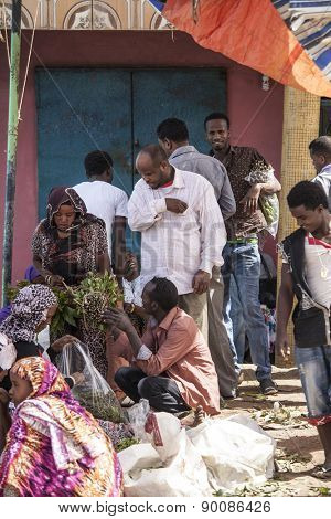 HARAR, ETHIOPIA-APRIL 17, 2015: Unidentified merchants and customers buy and sell Qat, an addictive stimulant, in the city of Harar, Ethiopia