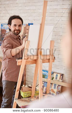 Young man drawing muse in studio