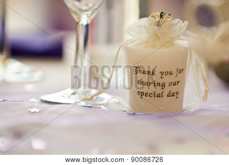 Inscripted Candle on Wedding Table