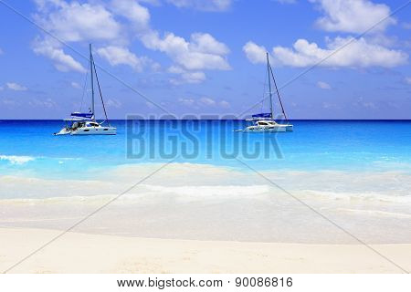 Yacht in the Indian Ocean on beach Anse Georgette.