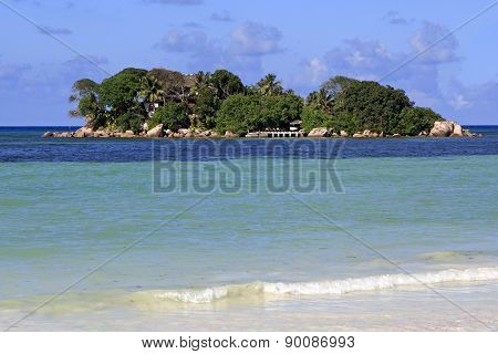 Island and hotel Chauve Souris Club in the Indian Ocean