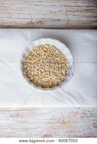 Barley Groats In White Bowl.