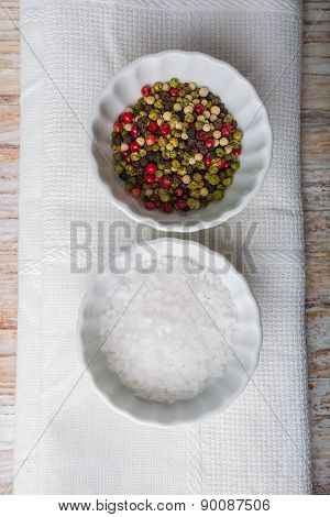 Salt And Pepper In White Bowls