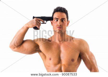 Suicidal man pointing a gun at his head