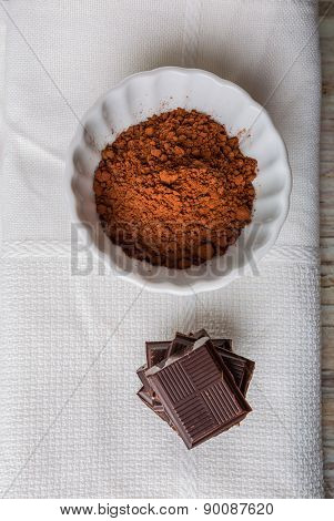 Cube Of Chocolate And A Bowl Of Cocoa