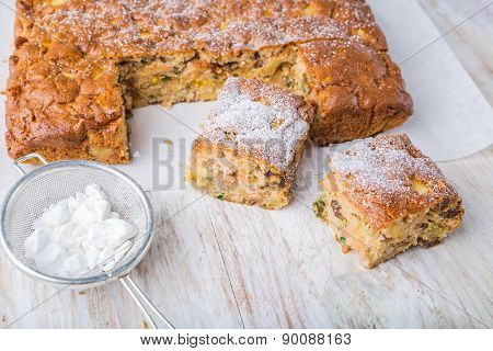 Homemade Cake With Dried Fruits On White Table