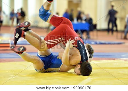 ST. PETERSBURG, RUSSIA - MAY 6, 2015: Amandyk Bakeyev of Kazakhstan against unidentified Russian athlete during International freestyle wrestling tournament Victory Day