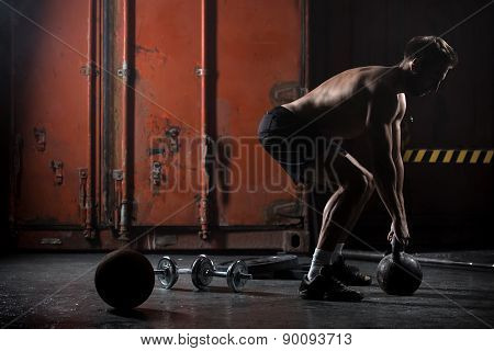 Beautiful athlete doing kettlebell swings