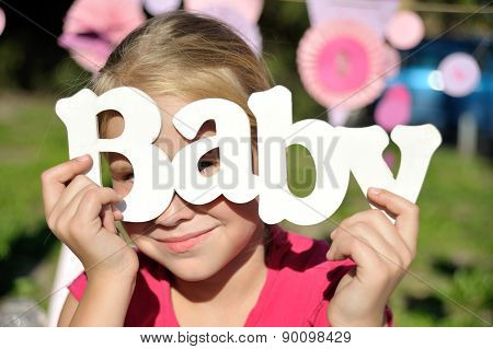 Word baby on wooden background