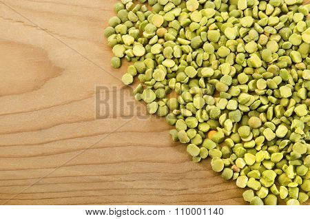 Green Splitt Pea On Rustic Wood