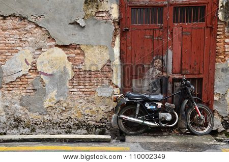 Street Mural Entitled Boy On A Bike  By Ernest Zacharevic In Penang.